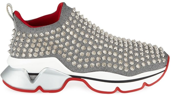 Christian Louboutin's metallic-silver neoprene trainers are punctuated with faceted enamel spikes for a statement mood
