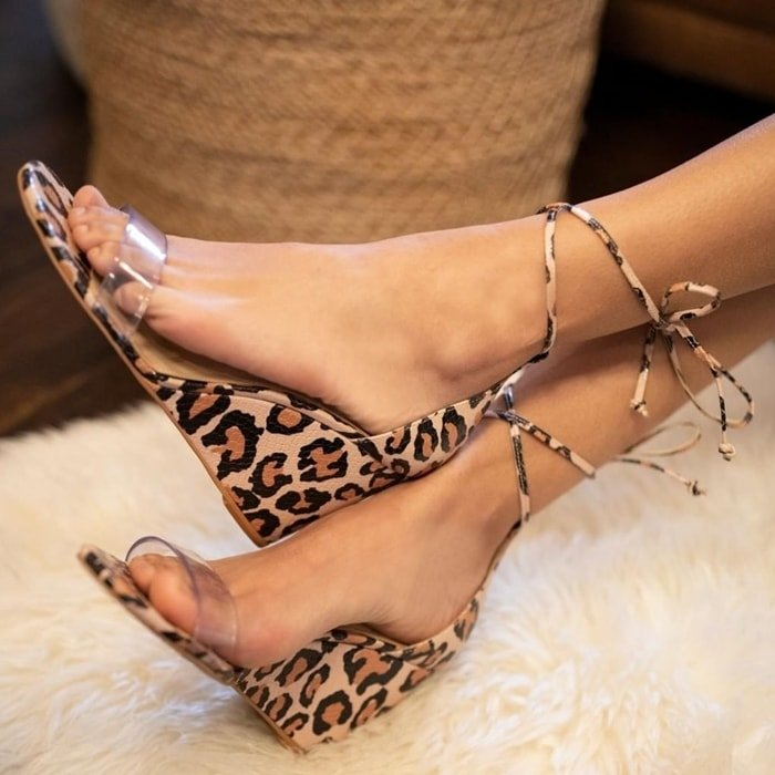 Lending a boost of height—with surprising comfort—the leopard Stassia sandals are styled with a clear PU toe band and slender ankle straps you can wrap and tie in different ways
