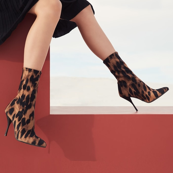 Sleek leather sock boots with a staggering stiletto heel and bold leopard-print finish