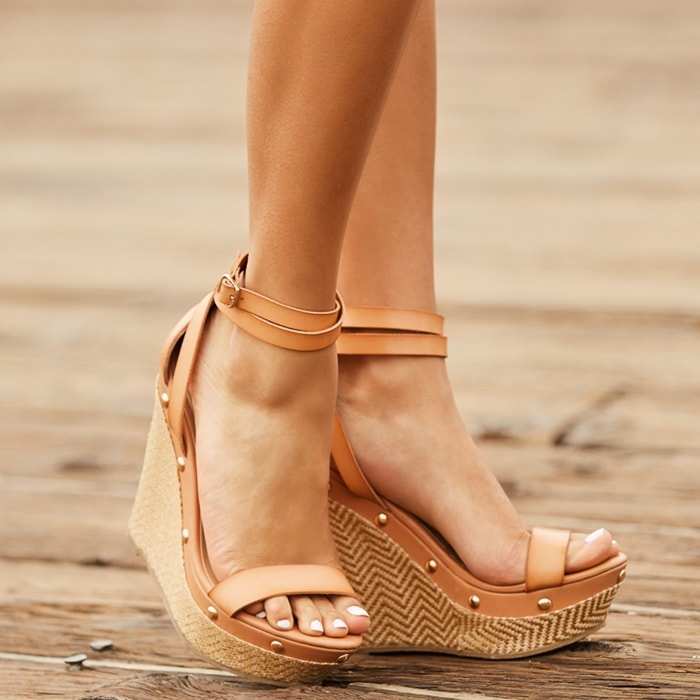 We love this platform espadrille wedge sandal with stud detailing and wraparound strap with buckle closure