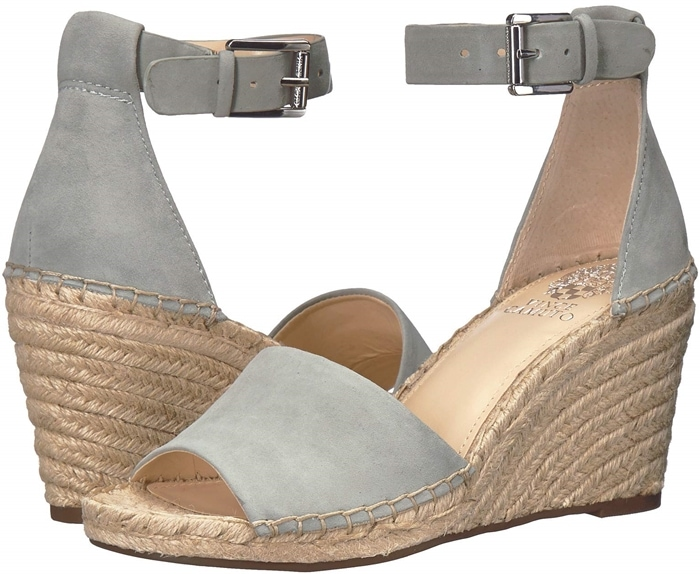 An espadrille-wrapped wedge underscores the warm-weather appeal of a platform sandal secured by a wide strap that wraps