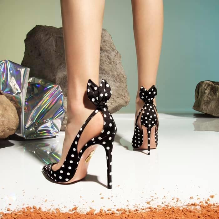 A pert bow perched at the back ties together the chic detailing of a polka-dot pump featuring side cutouts and a super-slim stiletto