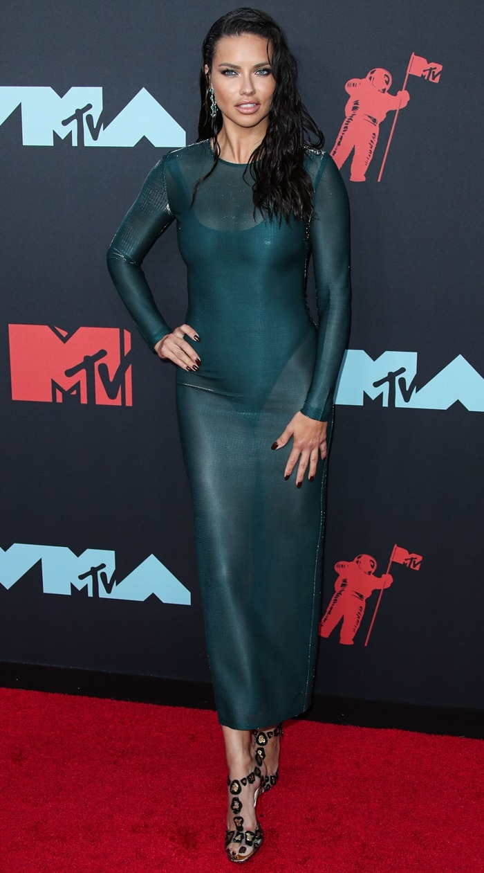 Model Adriana Lima wearing a Sally LaPointe dress, Christian Louboutin heels, and Chopard jewelry at the 2019 MTV VMAs
