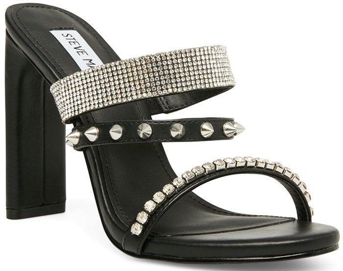 Crossing edgy spikes with sparkling rhinestones, the black AXELLE sandal is perfect for the bad girl with a penchant for glamour