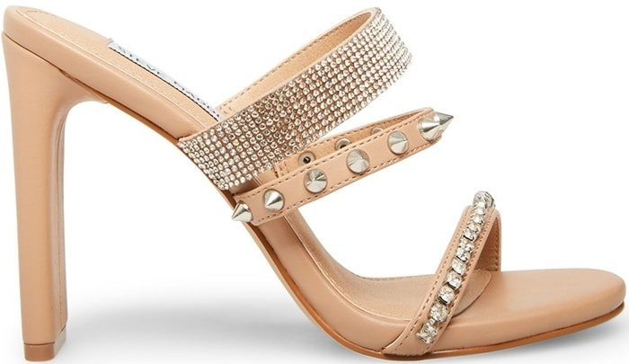 Crossing edgy spikes with sparkling rhinestones, the tan AXELLE sandal is perfect for the bad girl with a penchant for glamour