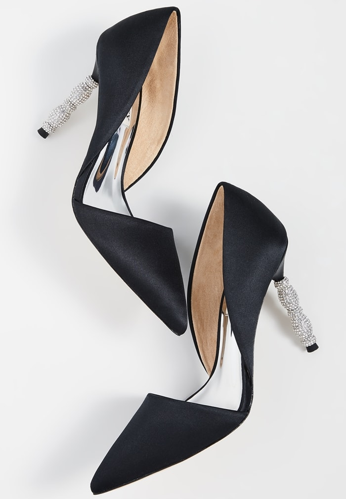 A sculptural heel featuring stacked geometric forms set with tiny pavé crystals simply dazzles on a black pointy-toe pump with a sophisticated d'Orsay silhouette