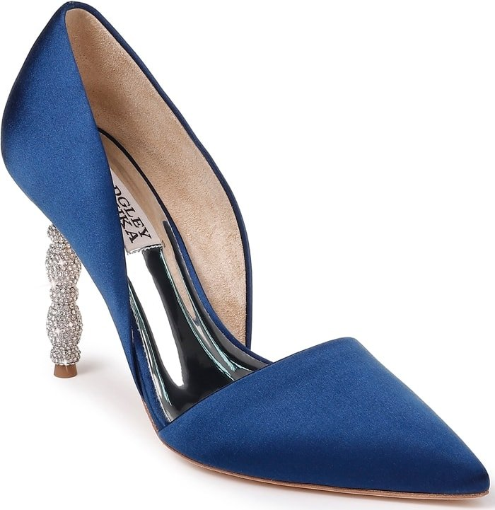 A sculptural heel featuring stacked geometric forms set with tiny pavé crystals simply dazzles on a navy pointy-toe pump with a sophisticated d'Orsay silhouette