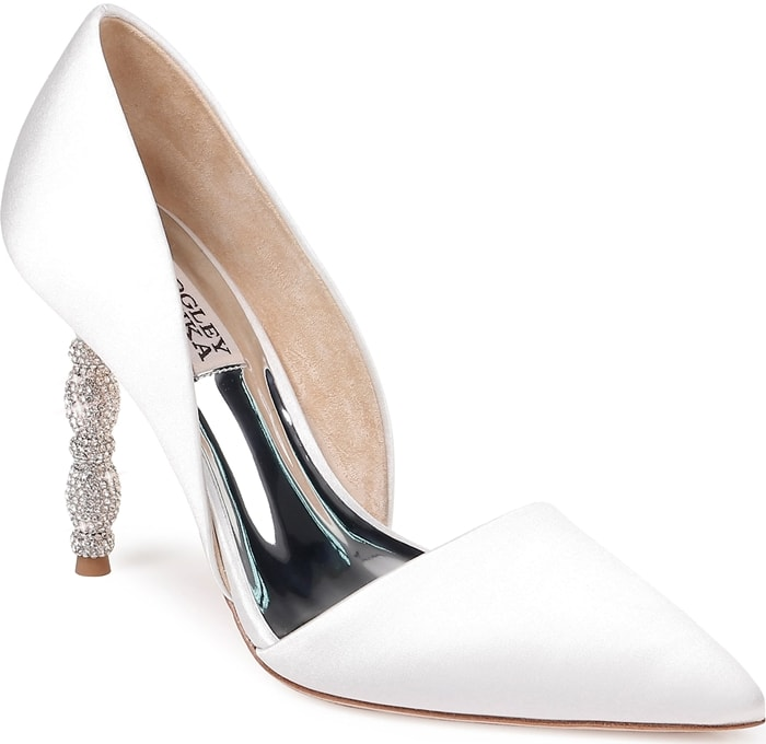 A sculptural heel featuring stacked geometric forms set with tiny pavé crystals simply dazzles on a white pointy-toe pump with a sophisticated d'Orsay silhouette