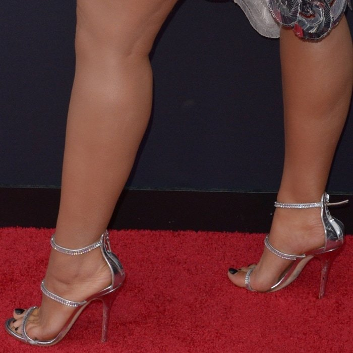 Bebe Rexha added several inches of height in towering sandals by Giuseppe Zanotti