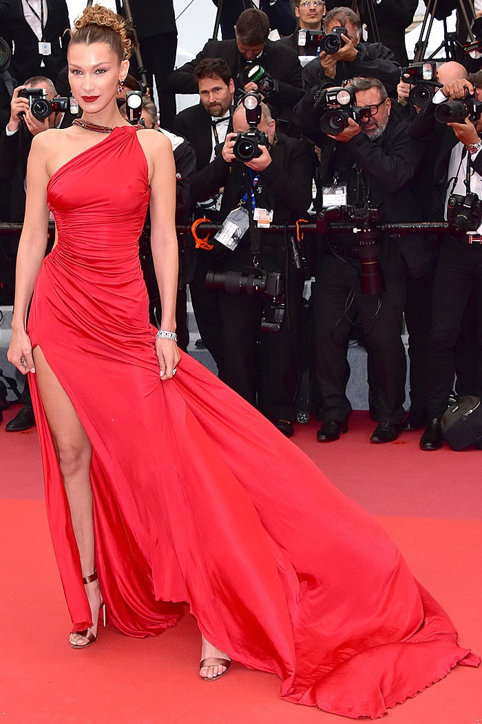Bella Hadid in a red Roberto Cavalli gown and Brian Atwood Babe sandals