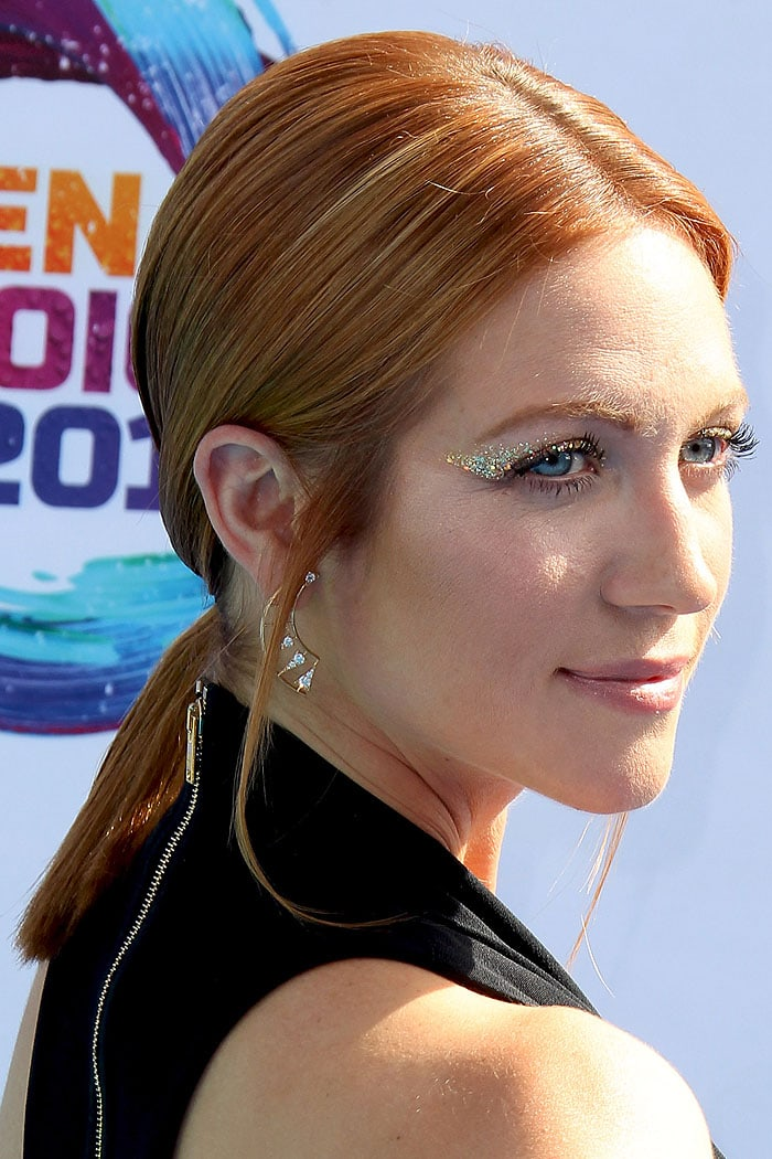 Brittany Snow sporting sparkly cat eye makeup