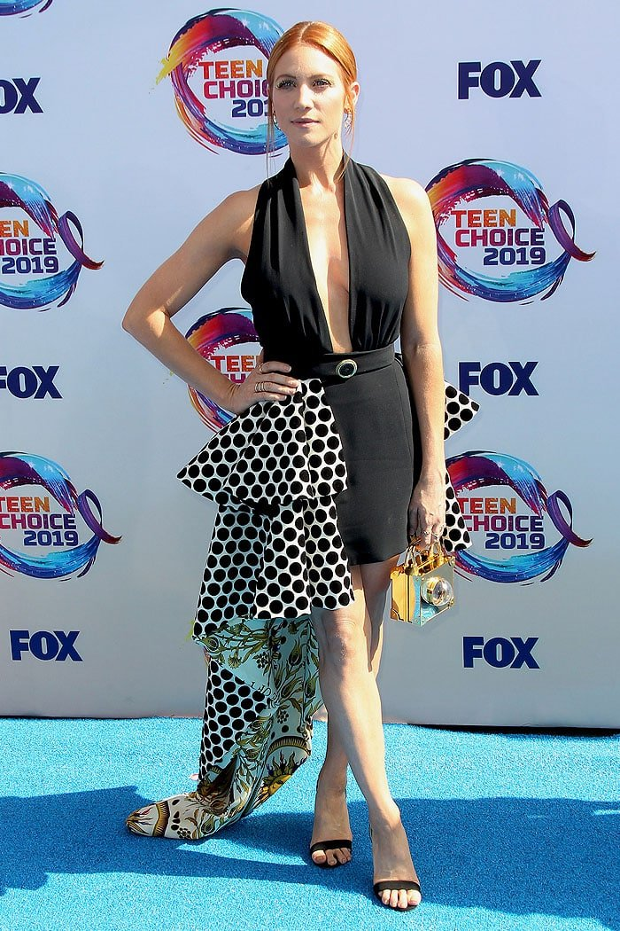 Brittany Snow in a Fausto Puglisi dotted-and-printed train dress