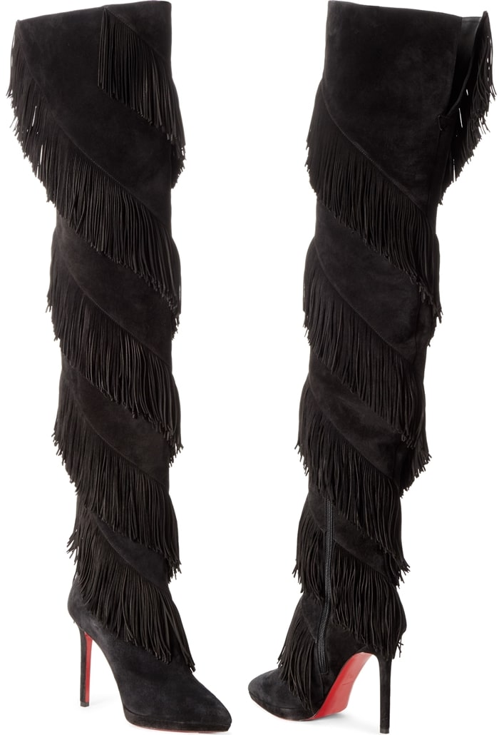 Unleash your urban cowgirl in this over-the-knee boot set on a stiletto heel and spiraled in fringe from top to vamp; a signature red sole finishes the look
