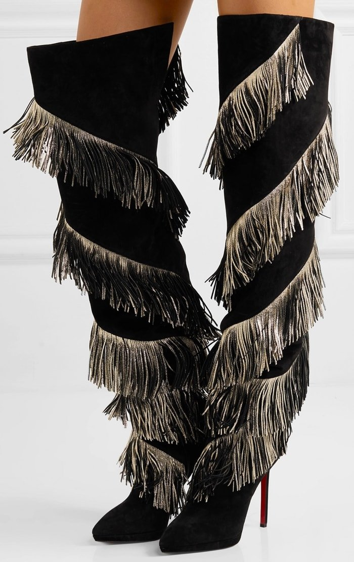 The Bolcheva boots have been made in Italy from soft suede and covered with spiraling tiers of swishy gold fringe