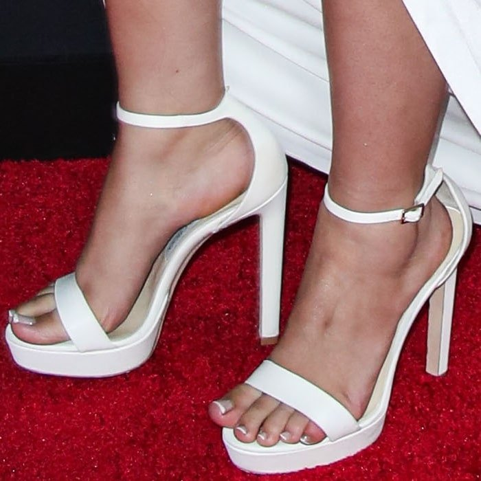 Camila Cabello increased her height by several inches in white Jimmy Choo Misty platform shoes