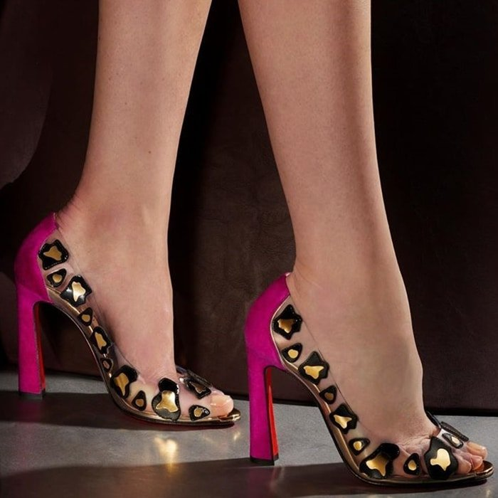 Embrace the transparent trend with these PVC and suede peep-toe pumps finished with an abstract animal-print appliqué