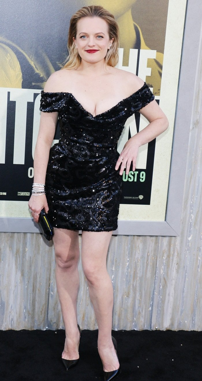 Elisabeth Moss' height is 5 feet 3 inches