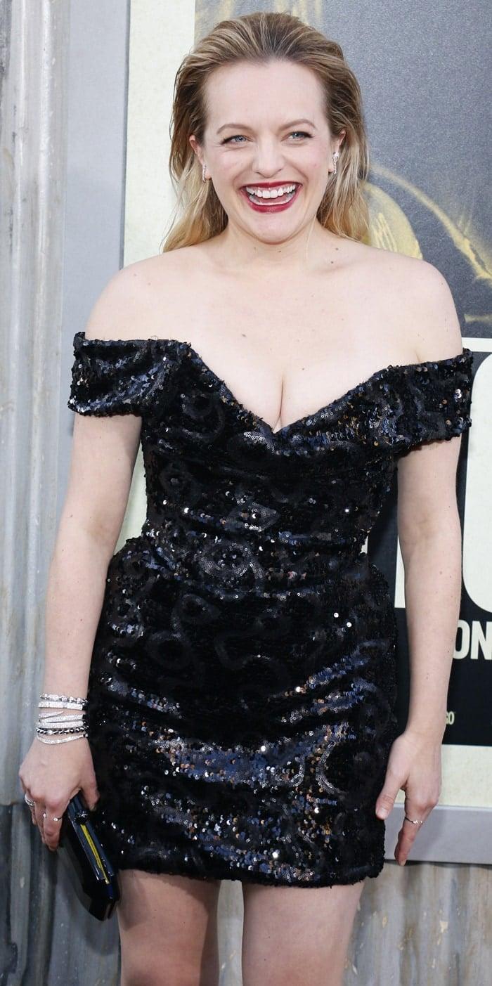Elisabeth Moss looked stumpy in a black sequin mini dress