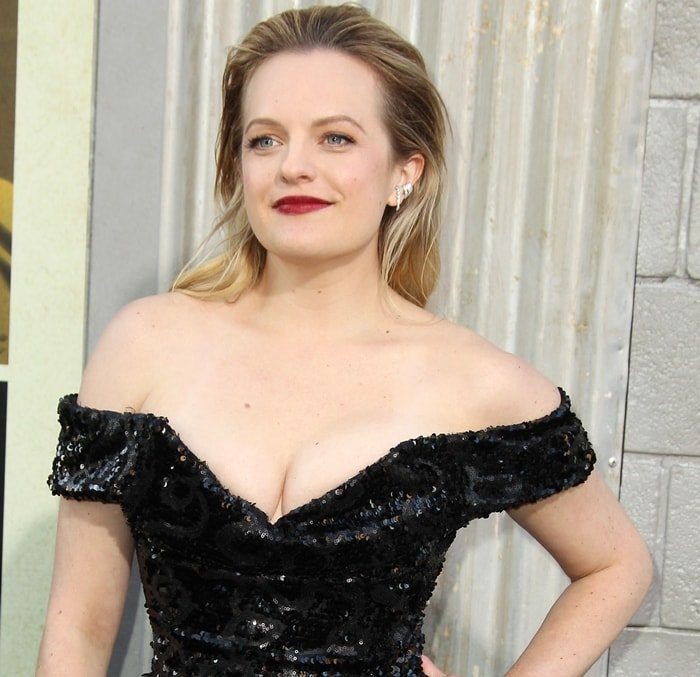 Elisabeth Moss accessorized with Anita Ko jewelry and wore deep red lipstick