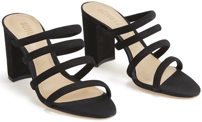 Attractive four-row straps make a dynamic statement on these essential black Felisa sandals