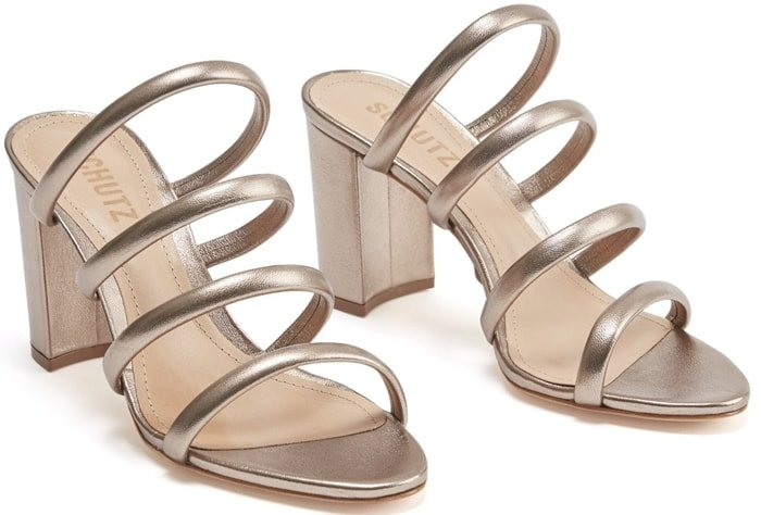 Attractive four-row straps make a dynamic statement on these essential gold Felisa sandals