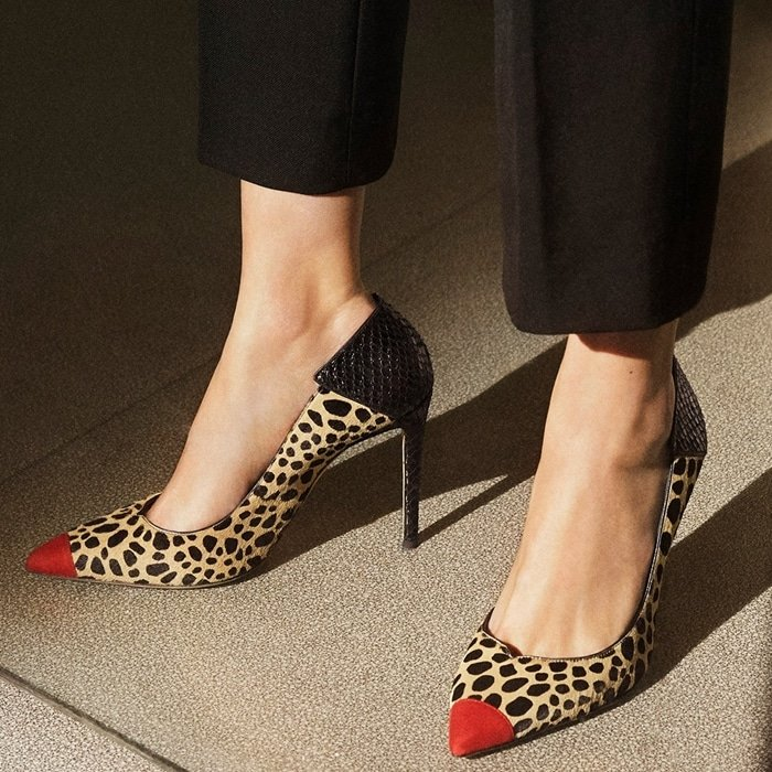 These high-heel, animal print natural pony pumps are characterized by the cocktail red suede patent insert on the front, and by the black alligator print leather insert on the back