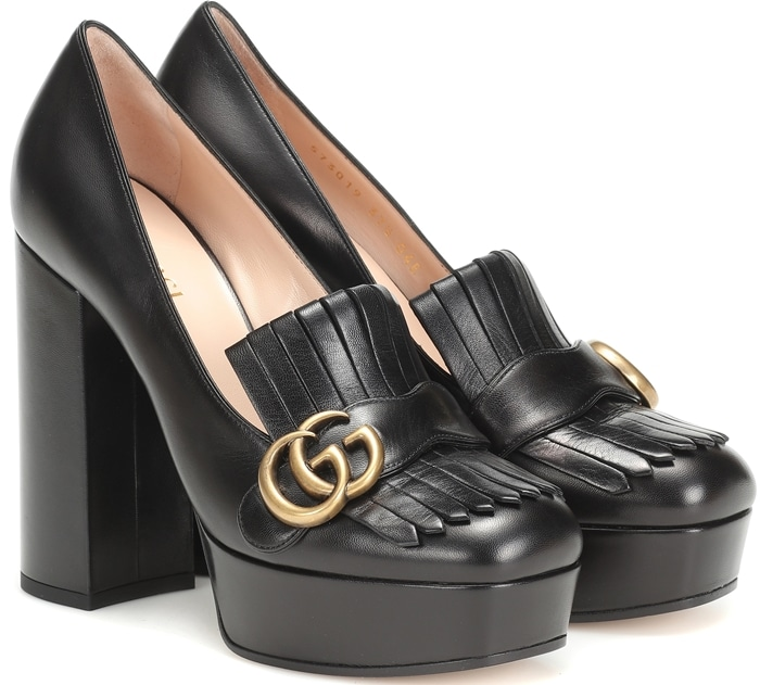 The platform pair has been crafted in Italy from black leather and is finished with chunky block heels