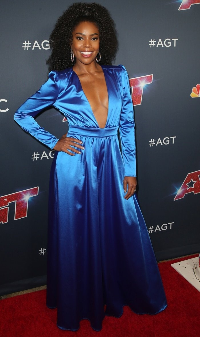 Gabrielle Union wears a blue jumpsuit at a live taping of America's Got Talent