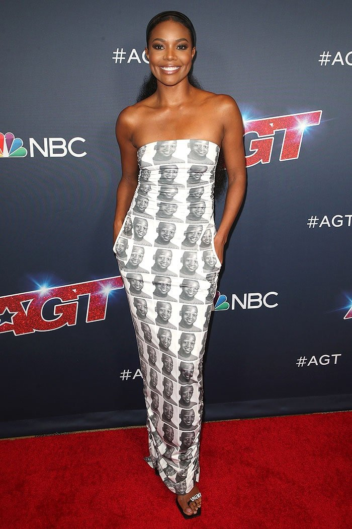 Gabrielle Union wearing a dress with her husband Dwyane Wade's face all over it