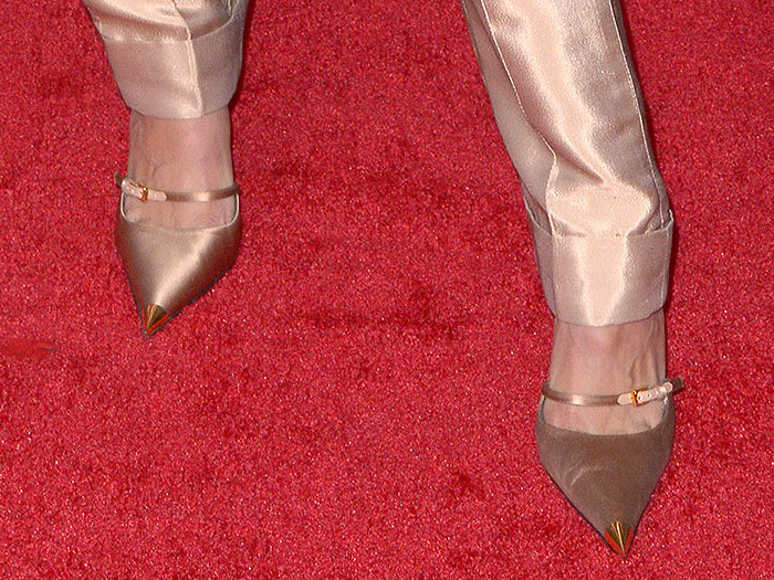 Gigi Hadid's feet in Tom Ford beige-satin two-strap mary-jane pumps with gold cap toes