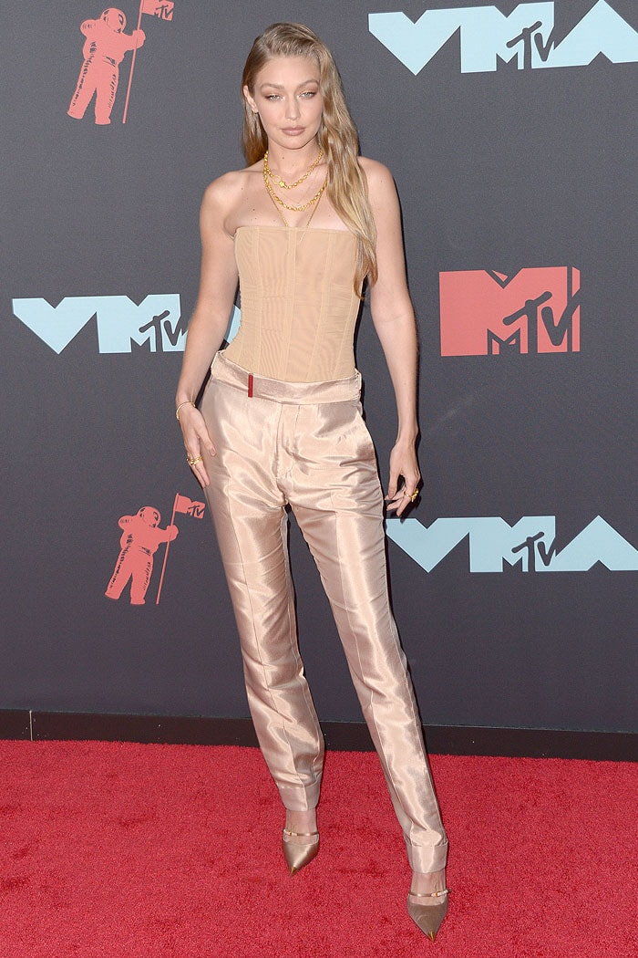 Gigi Hadid in a nude-colored outfit by Tom Ford