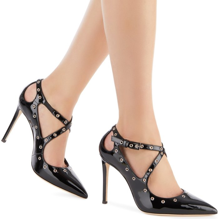 These black Alyson pumps are crafted from patent leather and feature a pointed toe, crossover straps to the front, a side buckle fastening, cut out details, a high stiletto heel, a branded insole and eyelet detailing