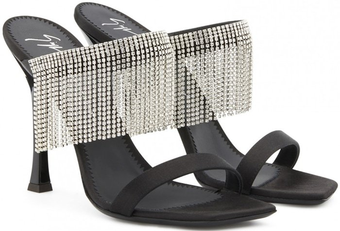Adorned with a crystal fringe on the strap, these black satin sandals are set on a chunky heel detailed with the house logo