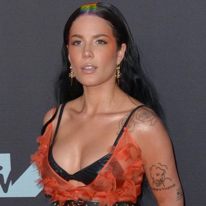 Halsey's rainbow-parted hair and tattoos