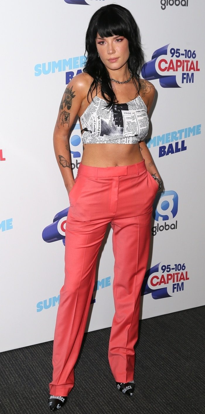 Halsey styled chic pants with a newspaper print crop top at the 2019 Capital Summertime Ball