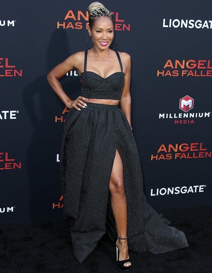 Jada Pinkett Smith flashed some leg in a voluminous ball skirt rendered in sturdy canvas, a utilitarian fabric imbued with sparkle, thanks to its delicate, pinned-up polka dot pattern