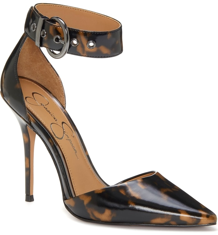 A round-buckled cuff cinches the ankle on a daring pump styled with a curvy d'Orsay profile and an impossibly slender stiletto