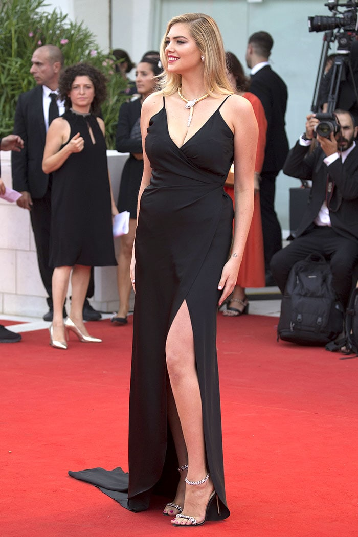 Kate Upton in a black wrap gown and Jimmy Choo sandals