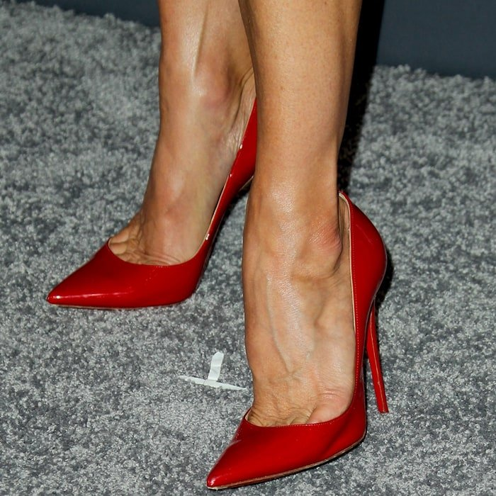 Katherine LaNasa's sexy feet in red patent pointy-toe high heels