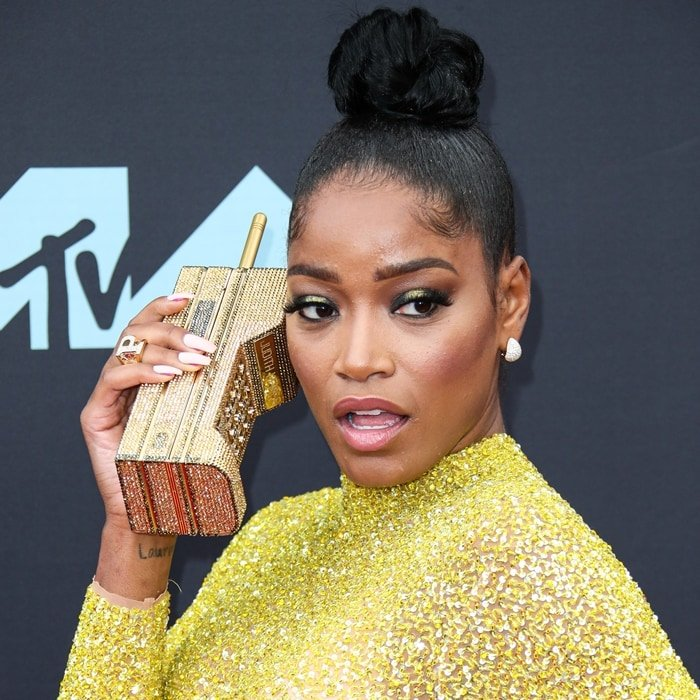 Actress Keke Palmer was disappointed when realizing she can't call anyone with her retro cellphone clutch bag