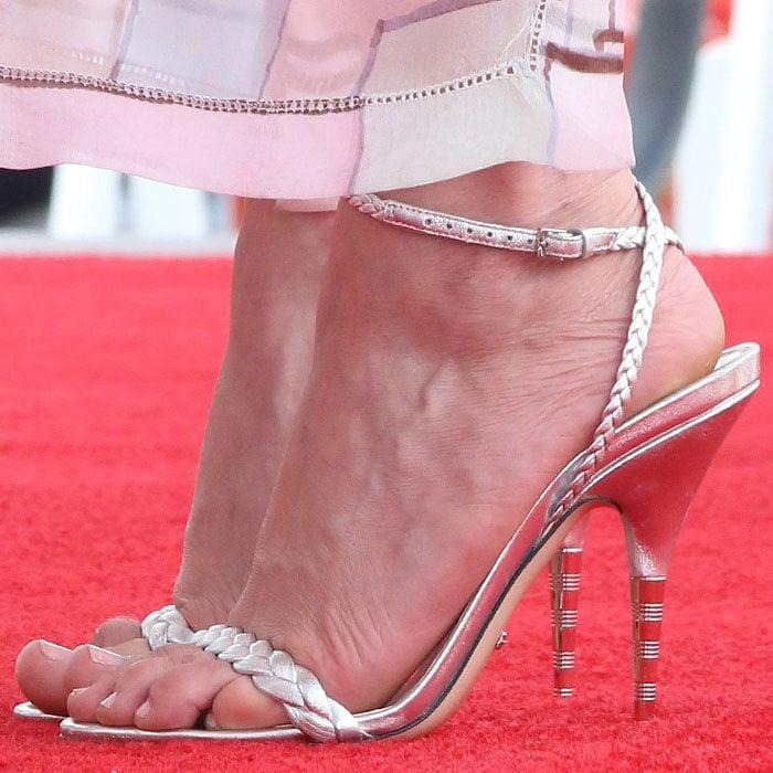 Kirsten Dunst's hot feet in Gucci braided metallic sandals