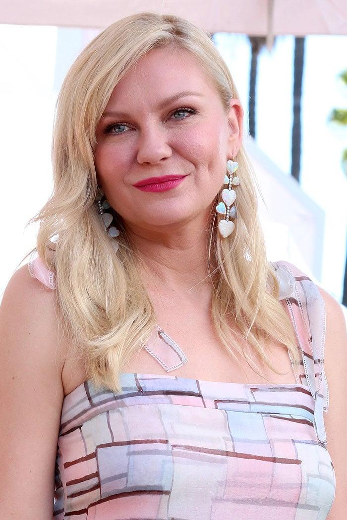Irene Neuwirth opal heart earrings on Kirsten Dunst