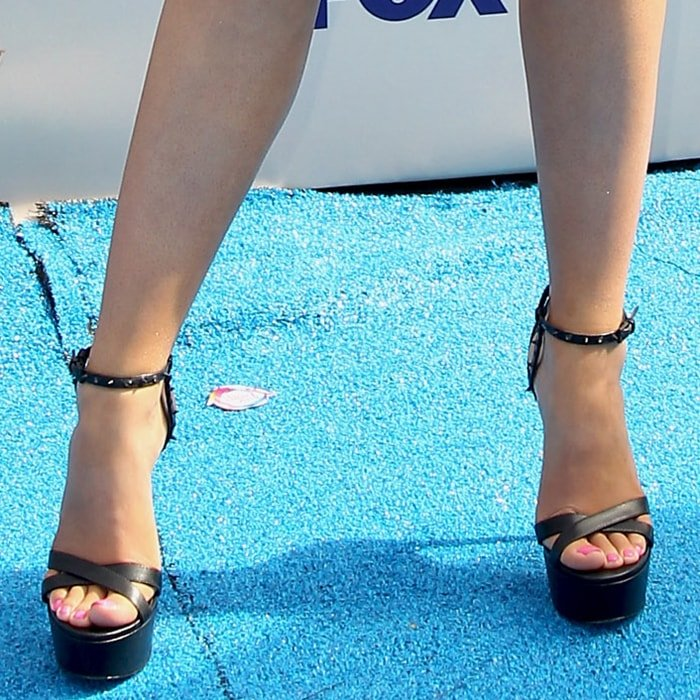 Laura Marano displayed her pedicured toes in black towering shoes