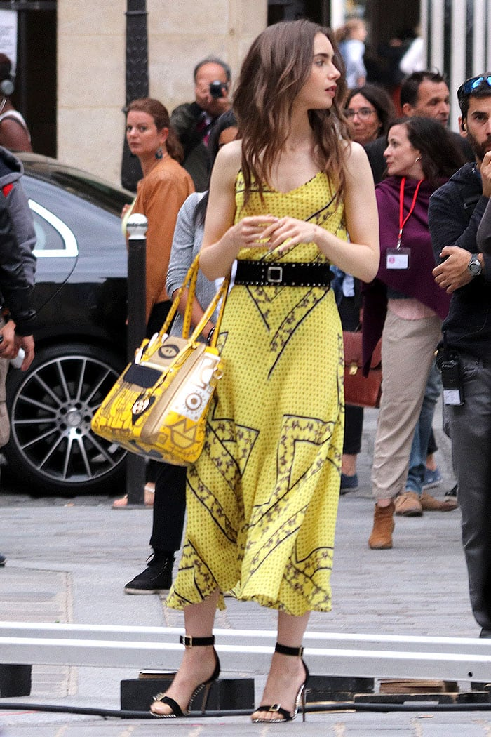 Lily Collins in a matching yellow Ganni printed top and midi skirt