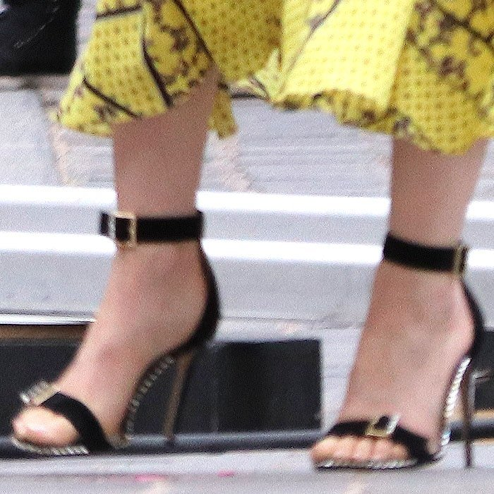 Details of Lily Collins' black heels with square-buckled straps and crystal border trim
