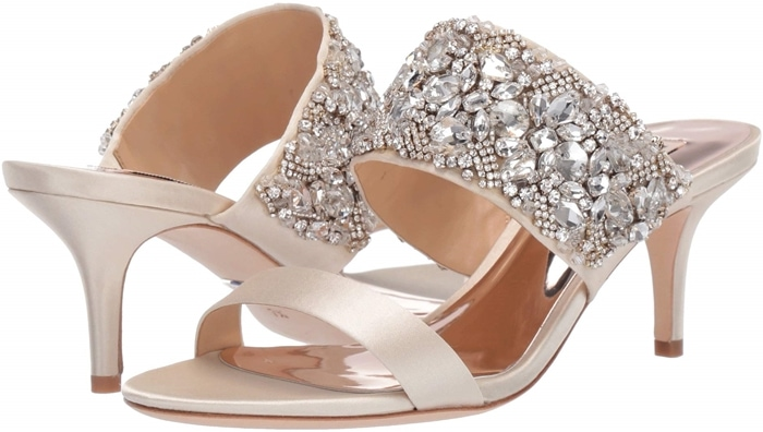 Linda is an open slide sandal featuring a crystal and bead embellished upper strap