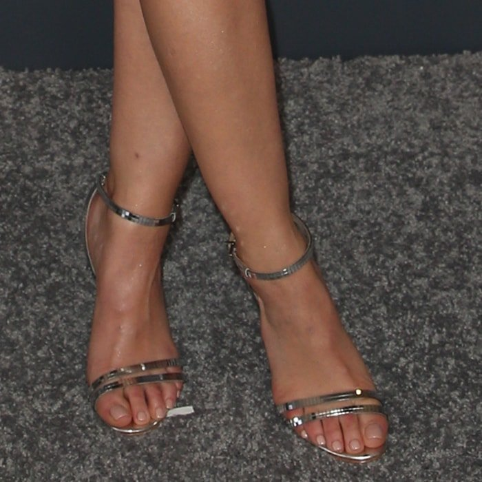 Lucy Hale's sexy feet in barely-there metallic leather Altina sandals
