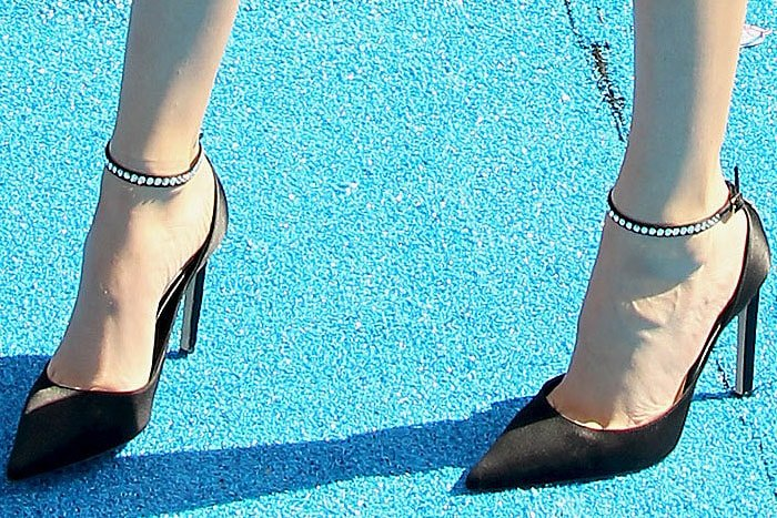 Madison Beer's feet in Jimmy Choo 'Helix' pumps with crystal-embellished ankle straps and stiletto heels
