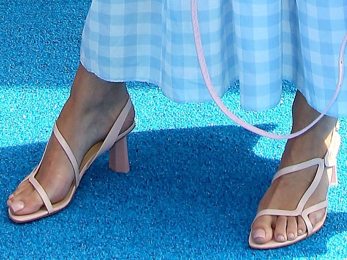 Maia Mitchell's pedicured feet in BY FAR 'Brigette' sandals