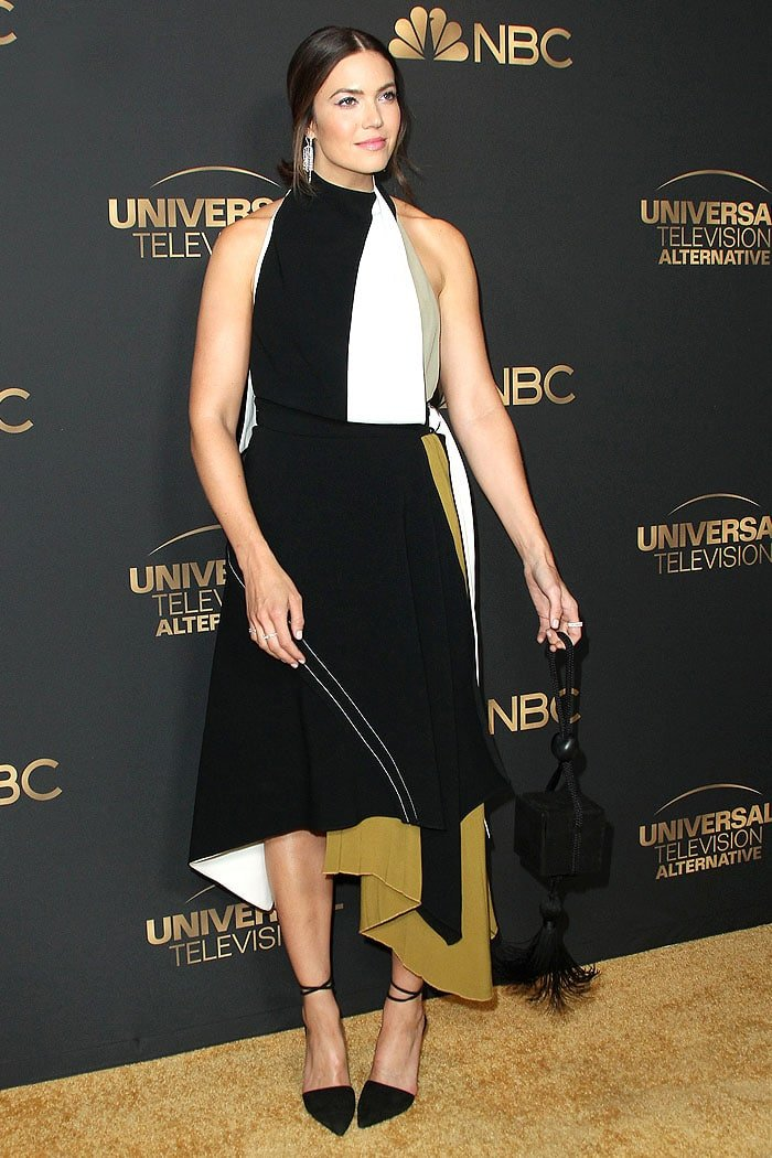 Mandy Moore in a Proenza Schouler geometric color-block dress and black-suede ankle-strap mules